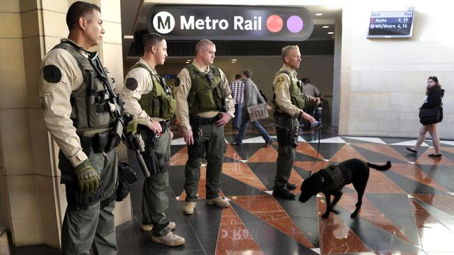 Cities around the world, such as Los Angeles, have ramped up visible security at railway stations and airports. Picture: AP Photo/Nick Ut.