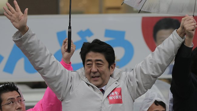 Japan's main opposition Liberal Democratic Party (LDP) President Shinzo Abe acknowledges the crowd during a campaign rally for the Dec. 16 parliamentary elections in Kawaguchi, near Tokyo, Saturday, Dec. 15, 2012. The LDP ruled Japan almost continuously since 1955 until it lost badly to the DPJ in 2009. If the LDP wins on Sunday, it would give the nationalistic Abe, who was prime minister from 2006-2007, the top job again. His hawkish views raise questions about how that might affect ties with rival China amid a territorial dispute over a cluster of tiny islands claimed by both countries. (AP Photo/Itsuo Inouye)