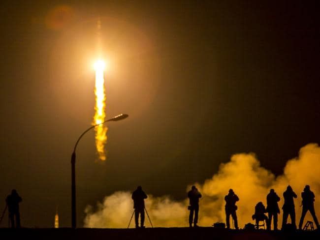 The Soyuz TMA-16M spacecraft is seen as it launches to the International Space Station carrying NASA Astronaut Scott Kelly, Russian Cosmonaut Mikhail Kornienko, and Gennady Padalka of the Russian Federal Space Agency (Roscosmos) in March this year. A space war would threaten launches such as this. Picture: Bill Ingalls