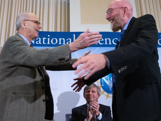 Breakthrough ... LIGO co-founder Rainer Weiss, left, and Kip Thorne, right, accompanied by LIGO executive director David Reitze. Picture: AP Photo/Andrew Harnik