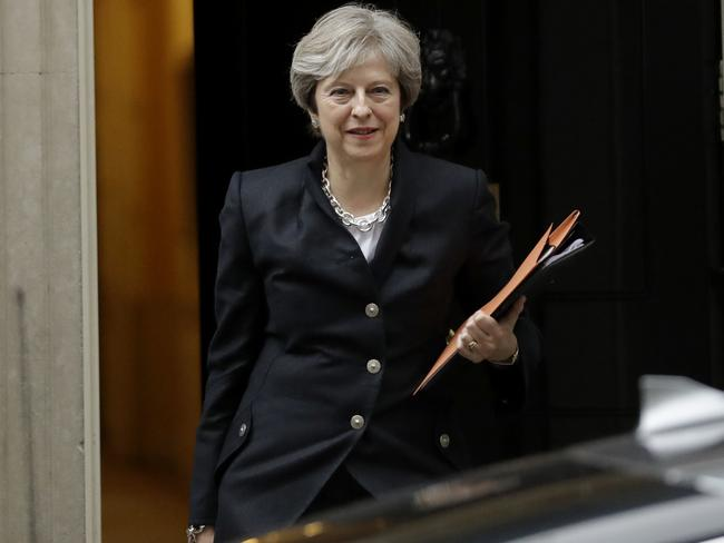 British Prime Minister Theresa May leaves 10 Downing Street to deliver a statement on Brexit to Parliament. Picture: AP Photo/Matt Dunham