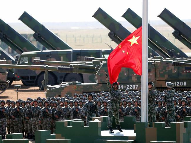 China has been building up its military while Donald Trump has been pursuing an American first policy. Picture: Pang Xinglei/Xinhua/AP