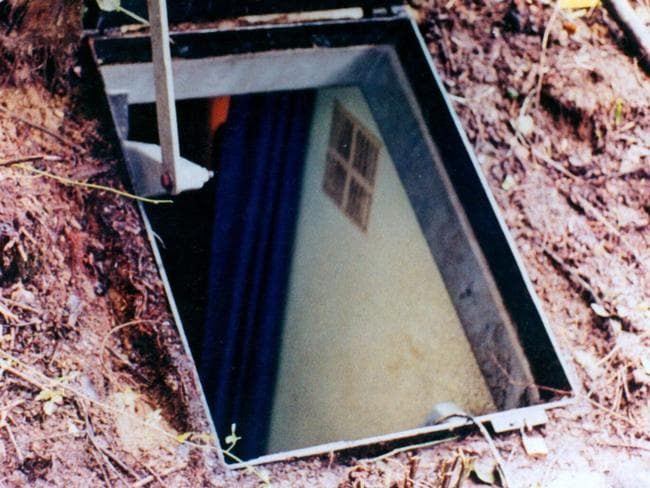 This undated police photograph shows the entrance of one of the bunkers used by Paul Schafer at Colonia Dignidad. Picture: AFP/HO