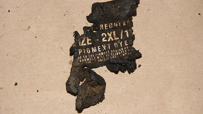 Burnt remnants of a T-shirt found with the headless torso.