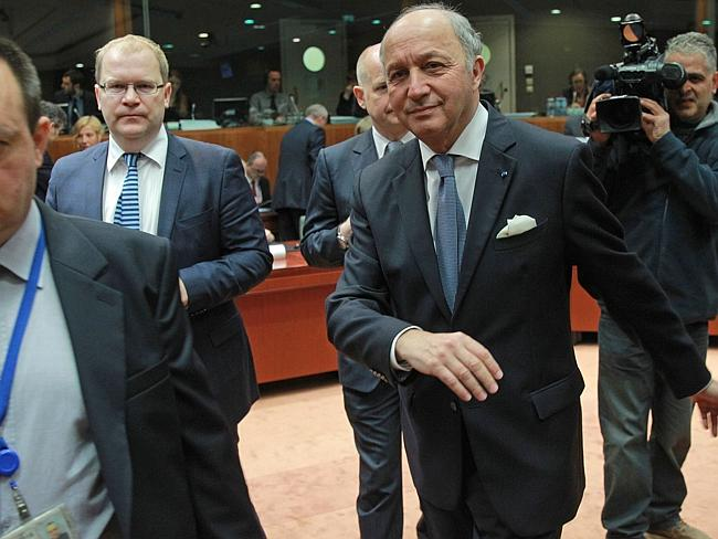 Diplomatic response ... French Foreign Minister Laurent Fabius, right, British Foreign Secretary William Hague, centre background, and Estonia's Foreign Minister Urmas Paet, second from left, walk towards their seat prior to the start of the EU foreign ministers council at the European Council building in Brussels.