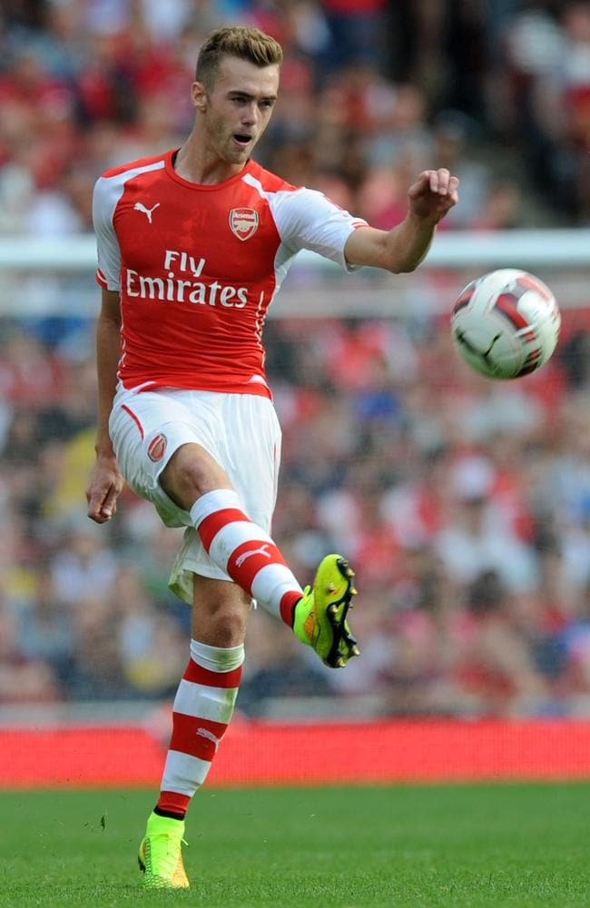 Arsenal's Calum Chambers kicks the ball upfield during the clash against Benfica.