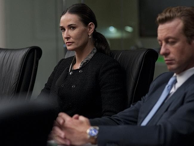 Demi Moore and Simon Baker in a scene from film Margin Call.