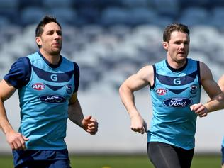 Harry Taylor (L) and Patrick Dangerfield of the Cats are seen during the team's training session in Geelong, in the lead up to the First preliminary final against the Adelaide Crows, Wednesday, September 20, 2017. (AAP Image/Joe Castro) NO ARCHIVING