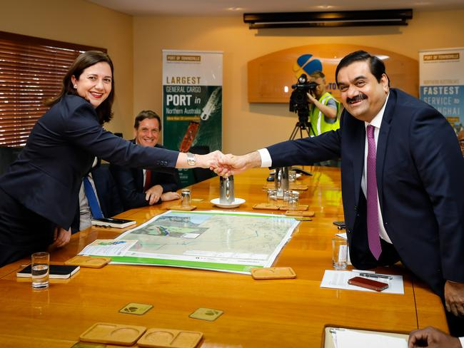 Adani Group chairman Gautam Adani meets with Queensland Premier Annastacia Palaszczuk in Townsville last year. The Queensland government has been given an 'iron clad' guarantee that Adani will not use 457 visas at its Carmichael mine and will prioritise local workers. Picture: Cameron Laird/AAP