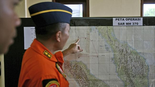 An Indonesia air force officer shows a map of Malacca Strait during a briefing at Suwondo air base in Medan, North Sumatra, Indonesia, Authorities hunting for the missing Boeing 777 have expanded their search areas to cover land and sea.