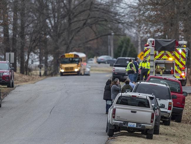 Parents pulled their cars up to the side of the road and waited for news on their children. Picture: Ryan Hermens/The Paducah Sun via AP