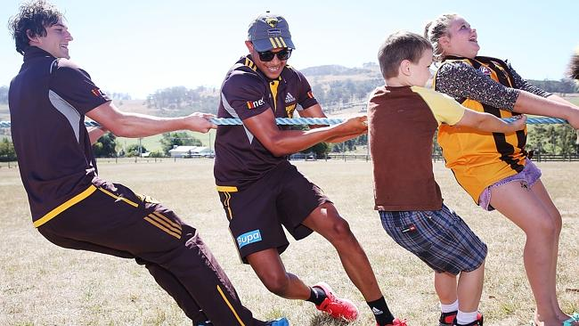 Hawk Dayle Garlett, middle, during a community camp in Tasmania. Picture: Getty