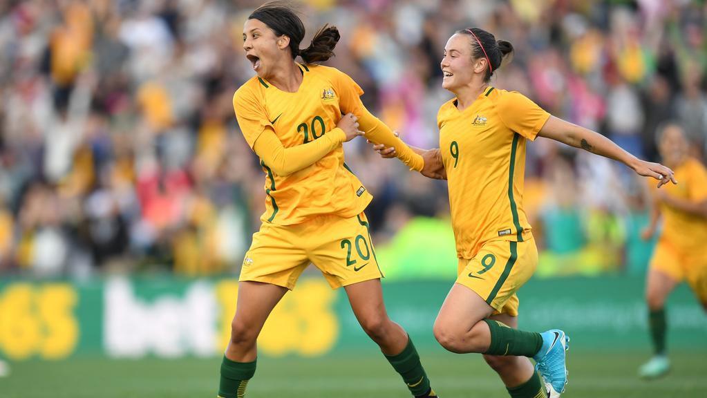 Sam Kerr (left) of Australia celebrates.