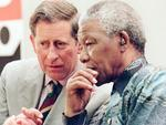PIRATE: South African /Pres Nelson Mandela shares a moment with Charles, Prince of Wales, as they visited Brixton in south London. 12/07/96. Royals