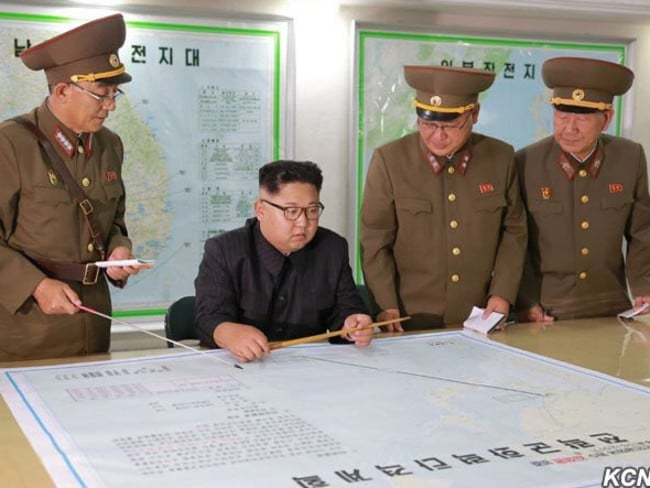 This North Korean supplied image purports to show Kim Jong-un being briefed at the KPA Strategic Force HQ on plans to launch ballistic missiles towards the US territory of Guam.