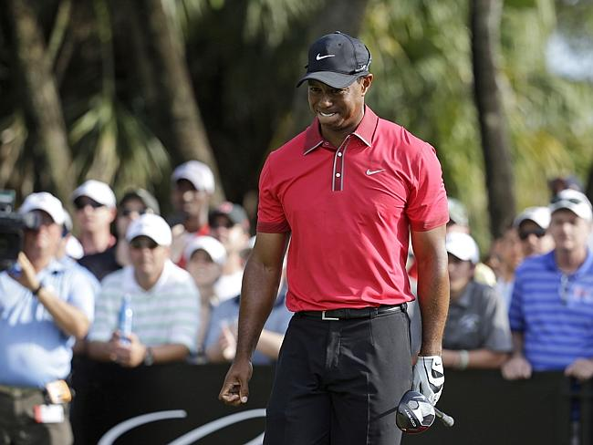 Tiger Woods grimaces after teeing off on the 12th during the final round of the Cadillac Championship.