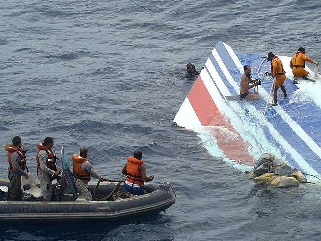 A Brazilian Navy crew clamber onto debris from the destroyed Air France jet. Picture: AP