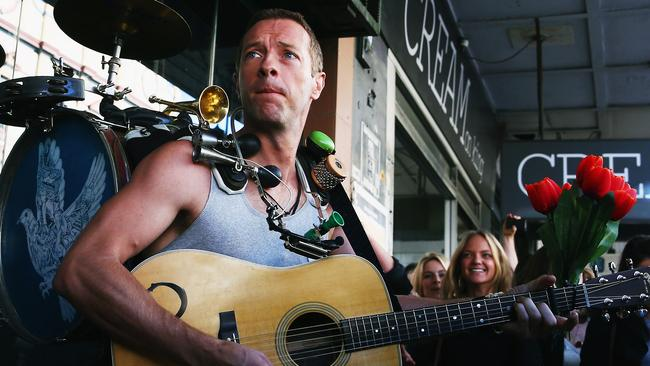 Public Shoot...Chris Martin of Coldplay is seen shooting a film clip along King Street in Newtown on Tuesday. Picture: Getty