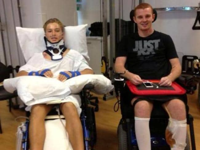 Forster-Tuncurry Junior Rugby League player Curtis Landers, 15, (who suffered fractures to his C2 and C3 vertebrae) and Newcastle Knights star Alex McKinnon (who suffered fractures to his C4 and C5 vertebrae) in the spinal ward of the Royal North Shore Hospital.