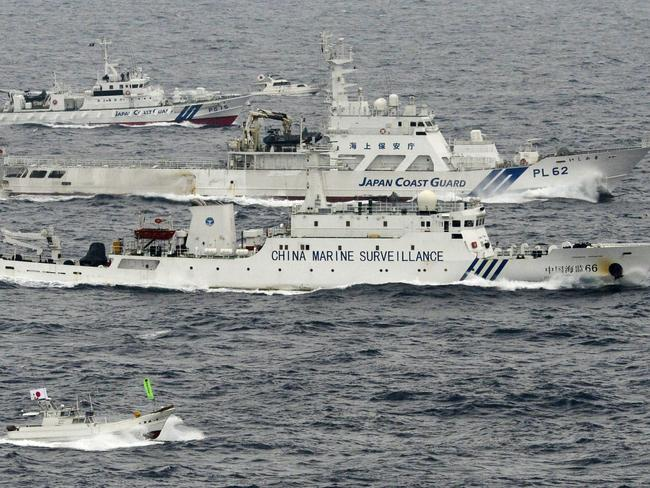 Resource wars ... A Japanese fishing boat, bottom, a small Japanese pleasure boat, top centre, Japan Coast Guard vessels, third and fourth from bottom and top left, sail along with a Chinese surveillance ship near disputed islands called Senkaku in Japan and Diaoyu in China in the East China Sea.