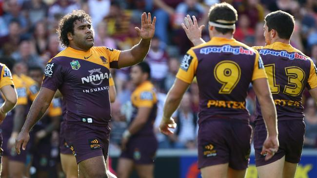 Sam Thaiday of Brisbane celebrates a try.