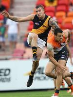 Eyes front ... Tiger Dustin Martin kicks away. Picture: Phil Hillyard
