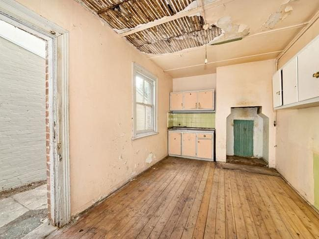 The dilapidated terrace sold for $100,000 more than the reserve.