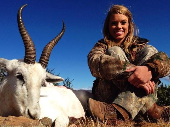"Kendall Jones and the white springbok she killed: ""Let me tell you it's one of my favourite kinds of meat so far!"". Source: Facebook."