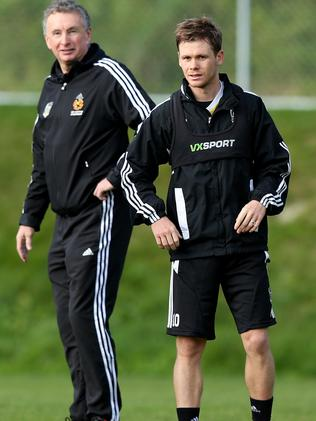 Michael McGlinchey and coach Ernie Merrick at a Wellington Phoenix training session.