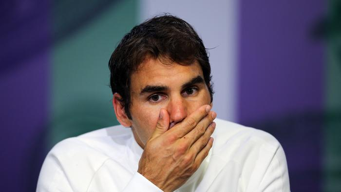 FILE - In this July 8, 2016, file photo, Roger Federer of Switzerland gives a press conference after being beaten in his men's semifinal singles match against Milos Raonic of Canada, at the Wimbledon Tennis Championships in London. Federer says he contemplated scenarios in which he would play in the Olympics and skip the U.S. Open, and vice versa. In the end, his balky left knee wouldn't allow him to do either. (Gary Hershorn/Pool Photo via AP, File)