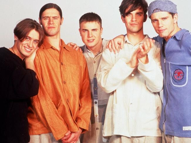 Take That in the 90s with former members Jason Orange and Howard Donald. Pic: Supplied