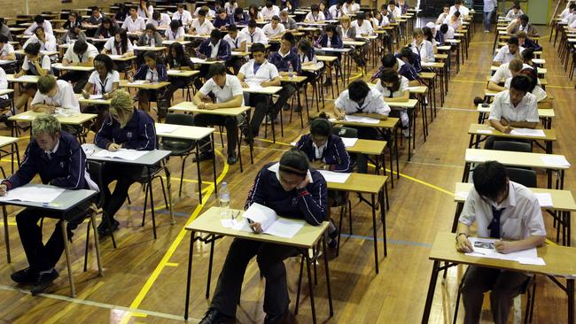 Past HSC students taking an exam.