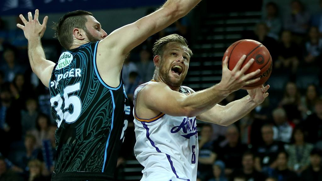 Brad Newley is blocked by a Breakers defender.