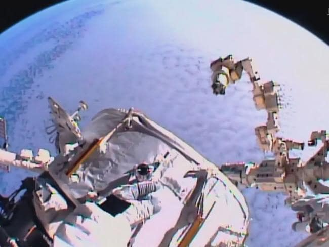 This NASA TV video grab shows US astronaut Kate Rubins adjusting cables on August 19, 2016 at the International Space Station.