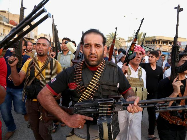 Training ground ... Iraqi Shiite tribal fighters deploy with their weapons while chanting slogans against jihadists to help the military, which defends the capital in Baghdad's Sadr City, Iraq.