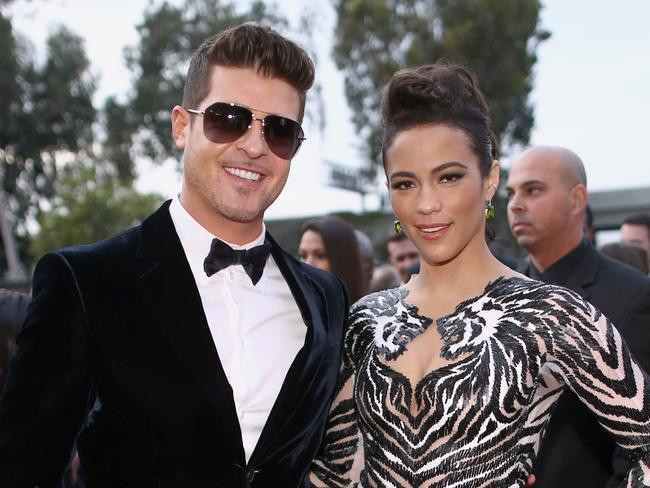Happier times ... Robin Thicke with estranged wife Paula Patto.