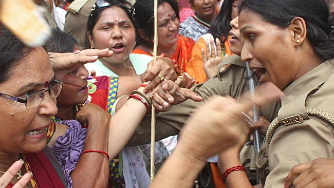 Cultural clash ... Indian demonstrators argue with policewomen during a protest against the recent gang-rape and murder of two girls, in Lucknow.