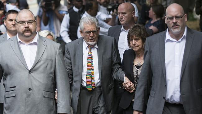 Holding hands ... Artist and television personality Rolf Harris arrives at Southwark Crown Court. Picture: Oli Scarff/Getty Images