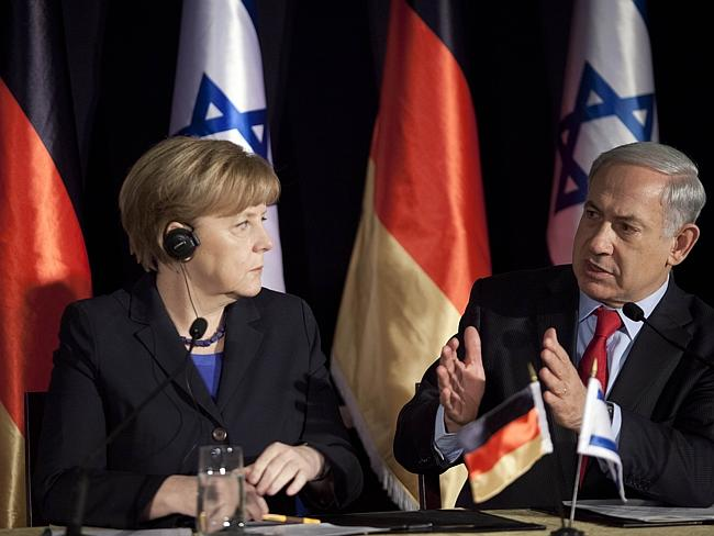 German Chancellor Angela Merkel is watching the hands of Israeli Prime Minister Benjamin Netanyahu closely.