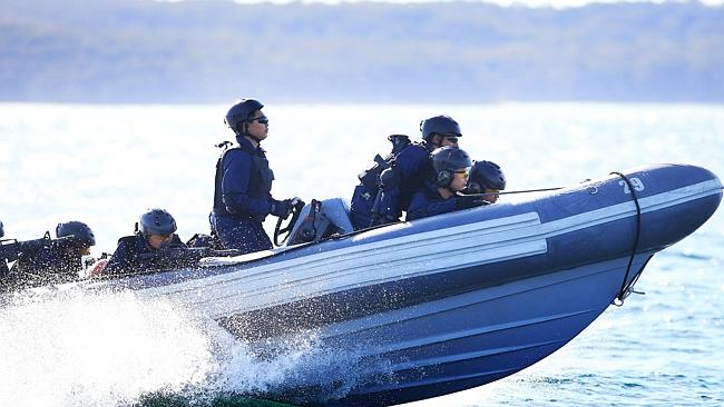 Malyasian commanders approach JS Makinami to board it in a training exercise at Creswell, Jervis Bay.