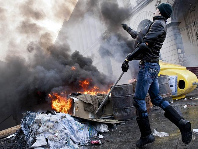 Violence erupts ... as anti-government protesters clash with riot police on Kiev's Independence Square. Picture: AFP