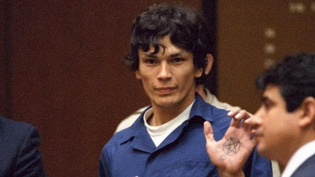 The 'Night Stalker' Richard Ramirez displays a pentagram symbol on his hand inside a Los Angeles courtroom in 1985. Picture: AP /Lennox McLendon.