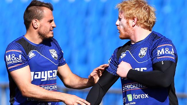 Josh Reynolds and James Graham joke around during a Bulldogs training session.