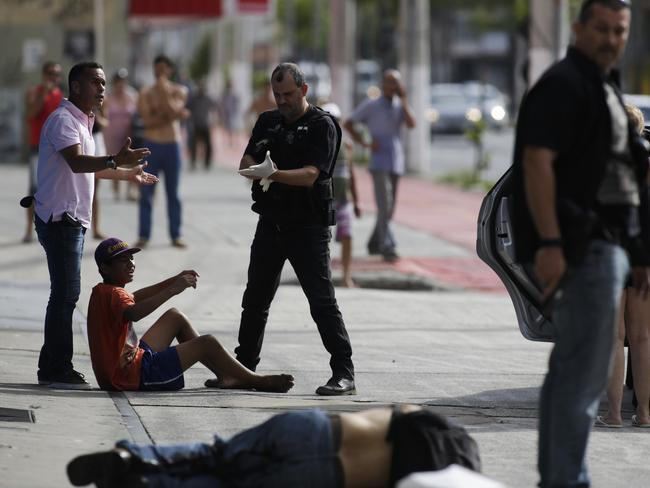 Civil police detain looters after they were shot in Vitoria, Espirito Santo state, Brazil. Picture: Diego Herculano/AP
