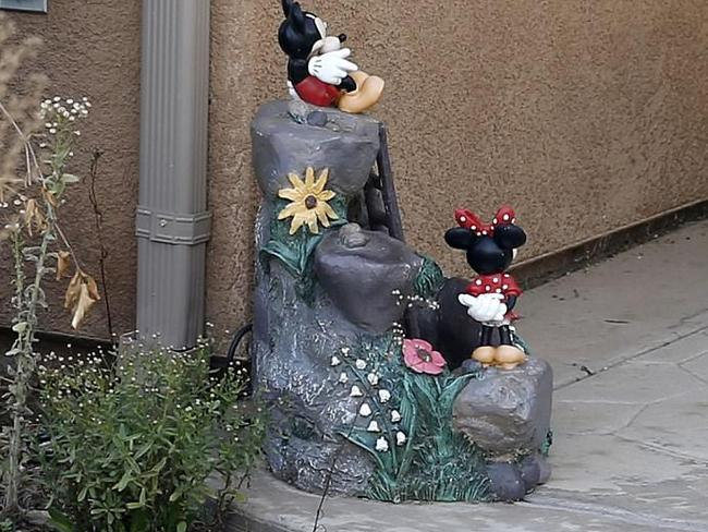 A Disney-themed sculpture scene in the back yard of David and Louise Turpin's house after their arrest.