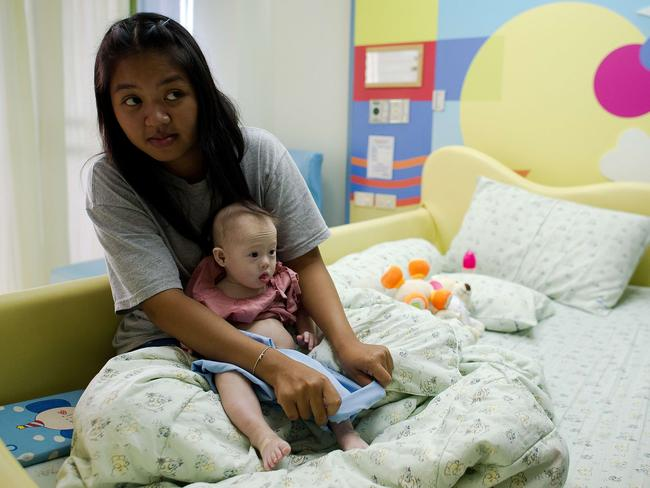 Claims the biological parents rejected Gammy ... Thai surrogate mother Pattaramon Chanbua, 21, with Gammy, who was born with Down syndrome. Picture: AFP