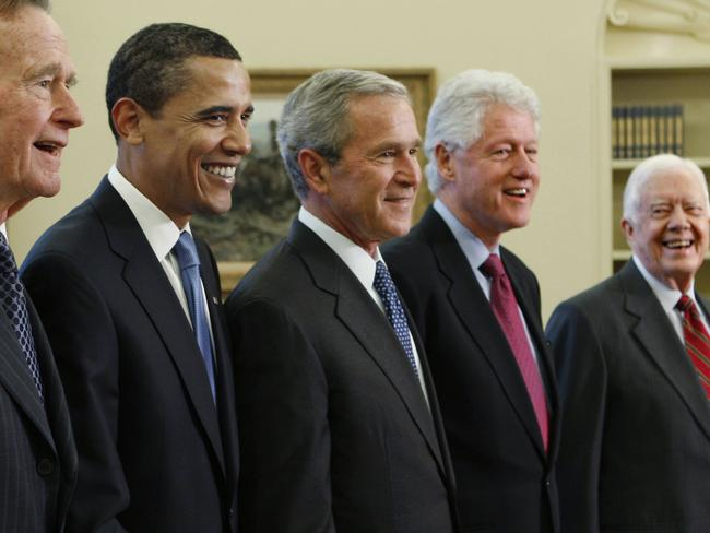 In file photo, George W. Bush, centre, poses Barack Obama, and former presidents, from left, George H.W. Bush, left, Bill Clinton and Jimmy Carter, right, in the Oval Office. Picture: AP.