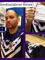 Nursing practitioner Clinton Foneca dons purple in support of the Dockers' finals campaign. Picture: Supplied.