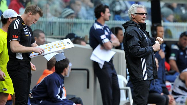 Mick Malthouse with Nathan Buckley during the 2011 Grand Final. Picture: Craig Borrow