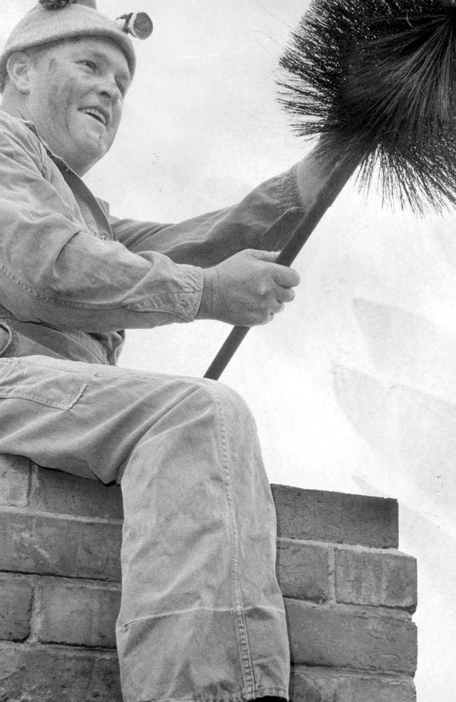 Fred King, chimney sweep hard at work in 1968. Picture: Herald Sun Image Library